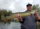 Junior with nice spring muskie while smallie fishing